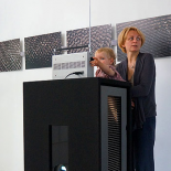 Rūta Mickienė with daughter Meda and the noise visualizations in the background.